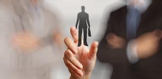 Main d'homme d'affaires choisissant l'icône de personnes Image libre de droits