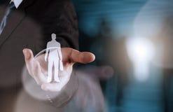 Main d'homme d'affaires choisissant l'icône de personnes Photo libre de droits