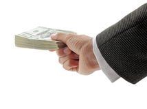 Homme d'affaires tenant la pile des dollars Image stock