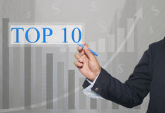 Main d'homme d'affaires Write un texte de TOP10 Photos libres de droits