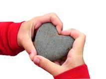 Main d'isolement d'amour avec la roche Photo libre de droits