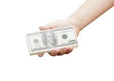 Main d'un homme tenant 100 billets d'un dollar Images stock