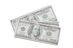 Main d'un homme tenant une poignée éventée de 100 dollars Images stock