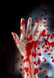 Main d'un tueur Images libres de droits