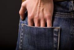 Main dans la poche Image stock