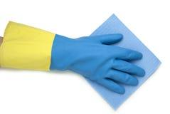 Main dans le gant bleu et jaune Image libre de droits