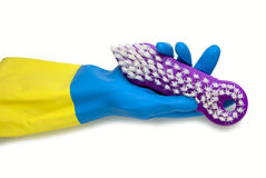 Main dans le gant bleu et jaune Image stock