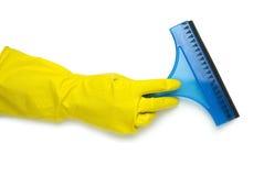 Main dans le gant jaune Photos libres de droits