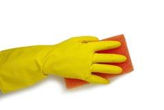 Main dans le gant jaune Image libre de droits