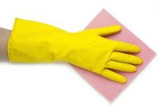 Main dans le gant jaune Images libres de droits