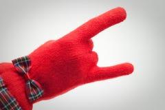 Main dans le gant rouge au-dessus du gris Photographie stock libre de droits