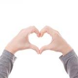 Main dans le symbole de coeur d'amour d'isolement sur le fond blanc Photos libres de droits