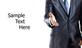 Main de élargissement d'homme d'affaires à la secousse Photo stock