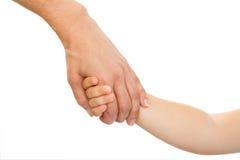 Main de chéris de fixation de main de mères. Image libre de droits