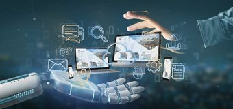 Main de cyborg tenant des dispositifs reliés à un rendu du réseau 3d de multimédia de nuage images stock