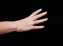 Main de femme affichant quatre doigts Photos libres de droits