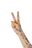 Main de femme en peinture avec le signe de victoire photographie stock