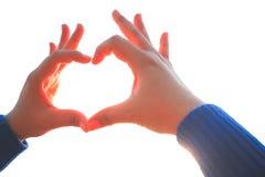Main de femme faisant le signe d'amour Image libre de droits