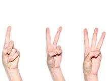 Main de femme faisant le signe numéro 1 2 et 3 Photographie stock