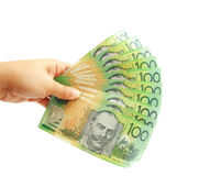 Main de femme retenant les dollars australiens Photo stock
