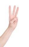 Main de femme sur le fond blanc d'isolement Trois doigts 3 Photo stock