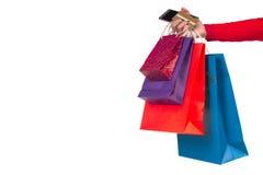 Main de femme tenant des sacs en papier d'achats, paquets, crédit bancaire Images libres de droits
