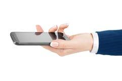 Main de femme tenant et touchant un écran de téléphone portable avec son t photographie stock