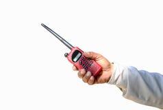 Main de garde de sécurité tenant la radio de talkie - walkie de Cb Image stock