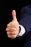 Main de l'homme tenant le pouce  Image libre de droits