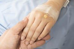 Main de patient de prise de main Photographie stock libre de droits
