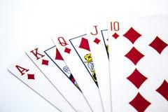 Main de poker de quinte royale sur le fond blanc Photographie stock libre de droits