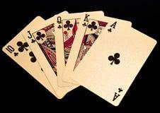 Main de poker jouante d'or royale de cartes de flux droit Photographie stock libre de droits
