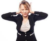Main de prise terrifiée par femme d'affaires sur la tête Photos stock