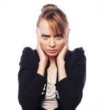 Main de prise terrifiée par femme d'affaires sur la tête Images libres de droits