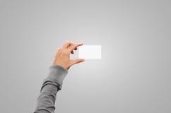 Main de pull dans la moquerie de carte de visite professionnelle de visite de prise de veste de chandail  Photos libres de droits
