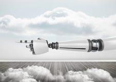 Main de robot d'Android se dirigeant avec le fond lumineux de ciel Photos libres de droits