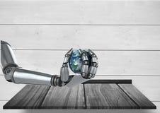 Main de robot d'Android tenant la terre de planète avec le fond en bois Image libre de droits