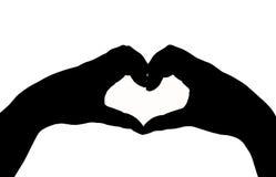 Main de silhouette dans la forme de coeur Photos libres de droits