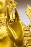 Main de statue d'or d'un dieu Photo stock