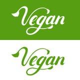 Main de Vegan écrite marquant avec des lettres le logo, label, emblème, icône Images stock