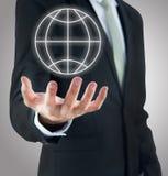 Main debout de posture d'homme d'affaires jugeant l'icône de la terre d'isolement Images libres de droits