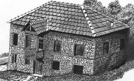 Main dessinant la vieille maison de pierres illustration libre de droits
