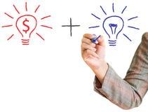 Main dessinant le signe du dollar d'ampoule Image stock