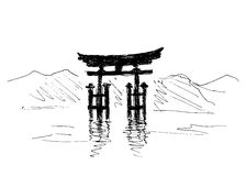 Main dessinant le torii japonais Photo stock