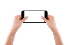 Main deux tenant le téléphone intelligent mobile photographie stock