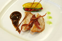 Main dish. Of pork with grilled vegetables and berries sauce royalty free stock photos