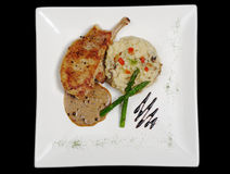 Main dish: Chop with Sauce, Rice and Asparagus Royalty Free Stock Photo