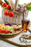 Main dish made with vegetables and kebab Stock Photos