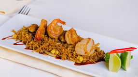 Main Dish Risotto with Shrimps on White Plate Stock Photo