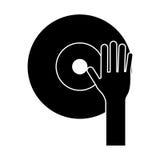 Main DJ jouant le pictogramme de vinyle Photo libre de droits